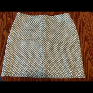 Talbots skirt with side pockets.